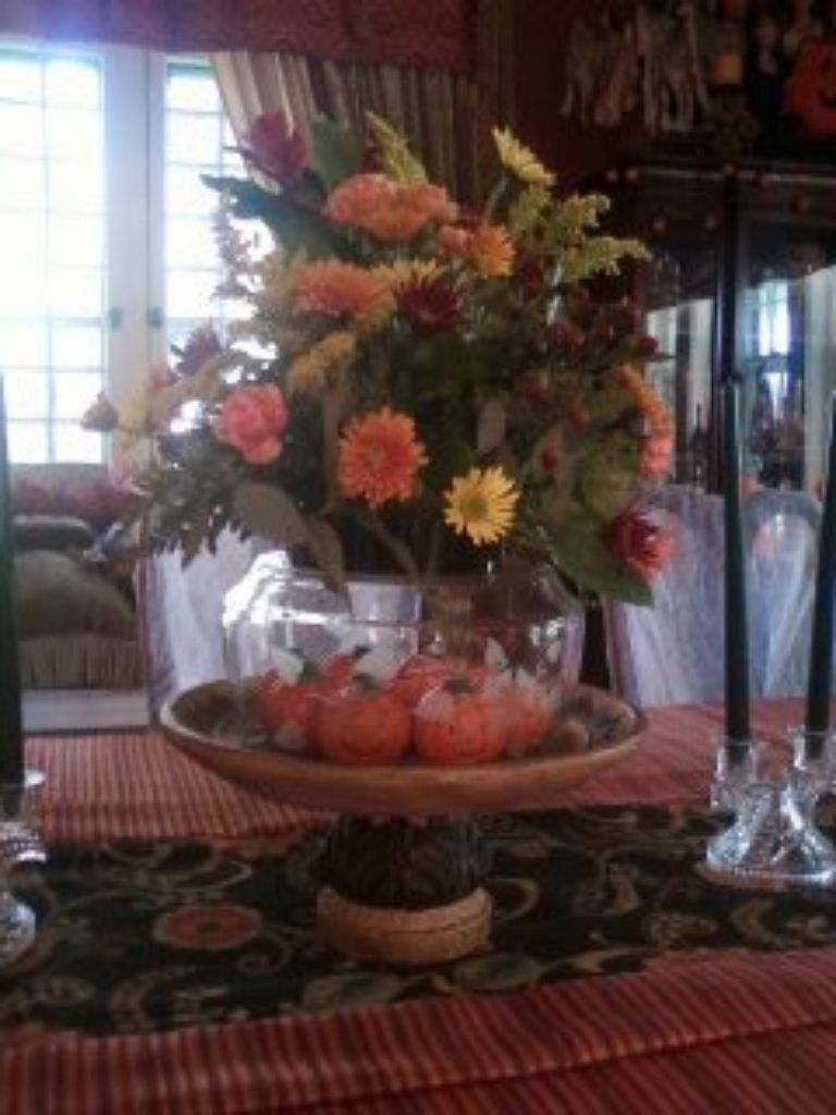 House of Gall-Add a clear bowl under your flower arrangements for height and more decor inside!