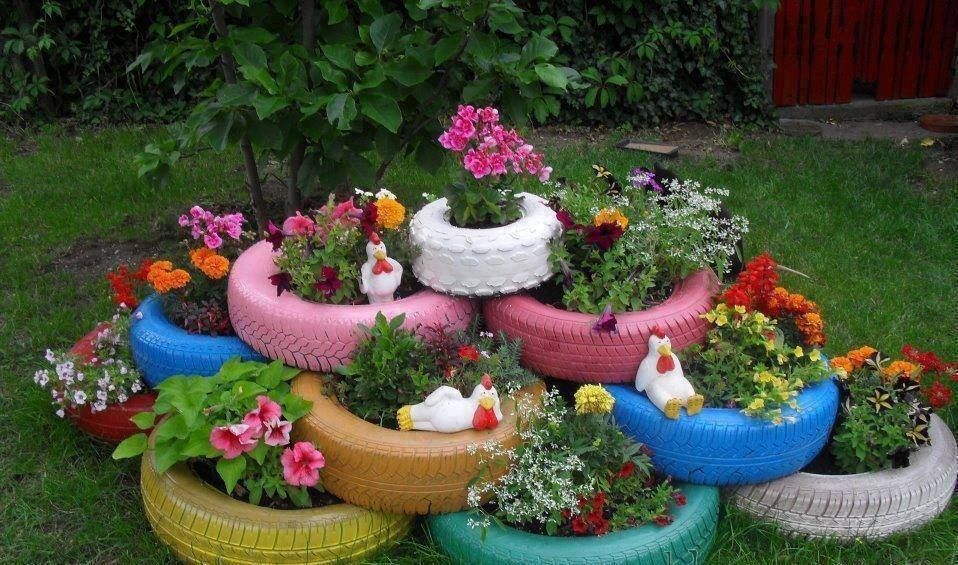 Pretty planters made from old tires with lazy chickens n all ;)