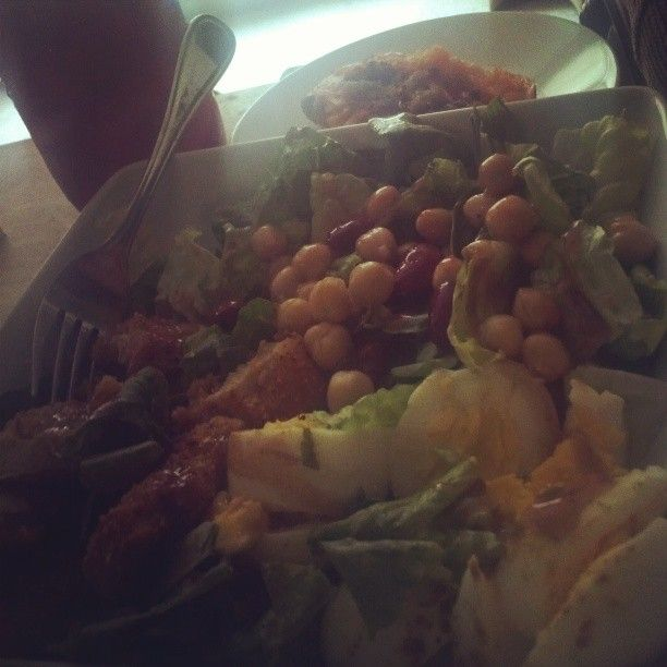 Hungry Gal Dinner: Mixed green  salad w/ eggs, two chic'n strips, chick peas, and kidney beans and half  sweet potatoe on the side. I just might eat the other half!