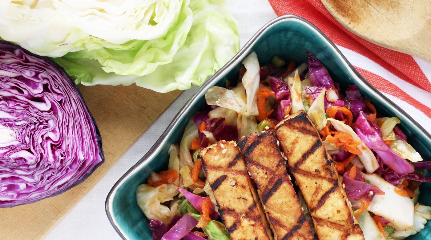 Dressed in gingery soy sauce and crunchy sesame seeds chargrilled fingers of tofu are coupled with a tender cabbage salad in this light freezer meal recipe.