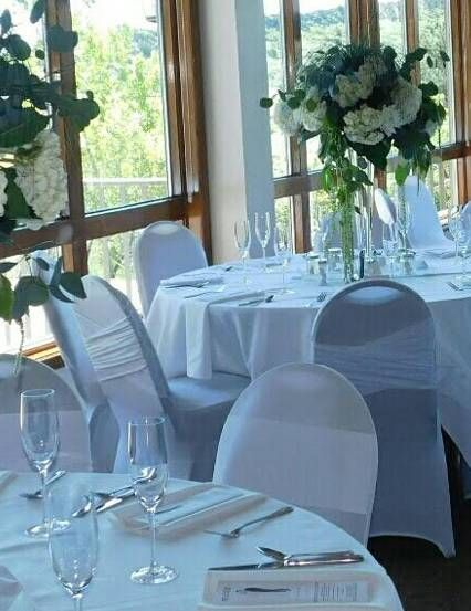 """Stunning white on white flip tie and  """"Madrid style"""" chair covers!"""
