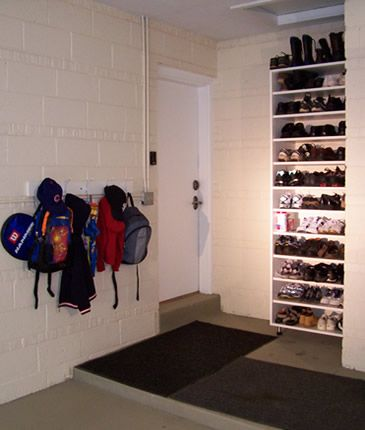 Awesome Shoe Rack And Coat In The Garage Not Cluttering Up Home