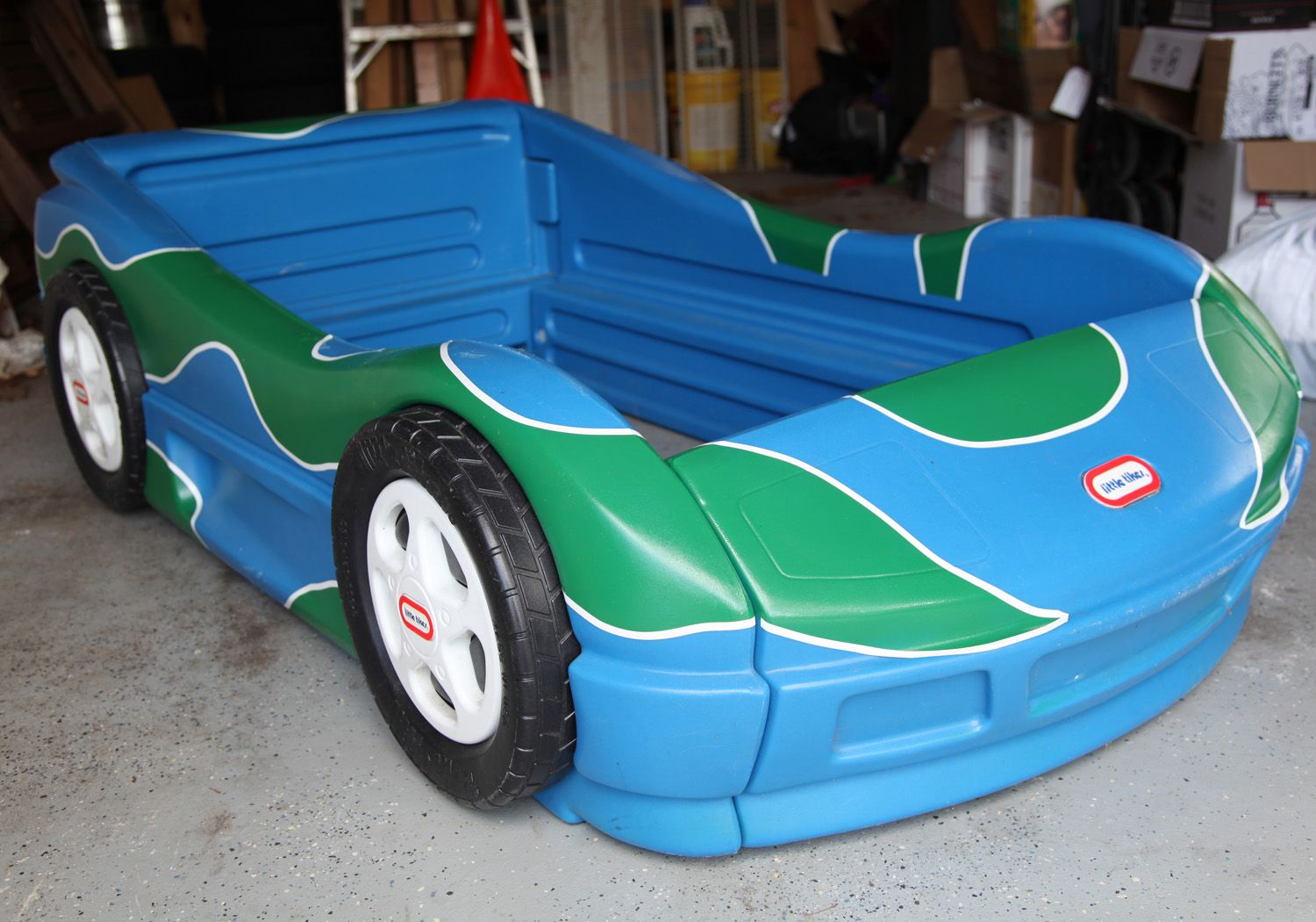 Blue little tikes car bed with added paint and decal
