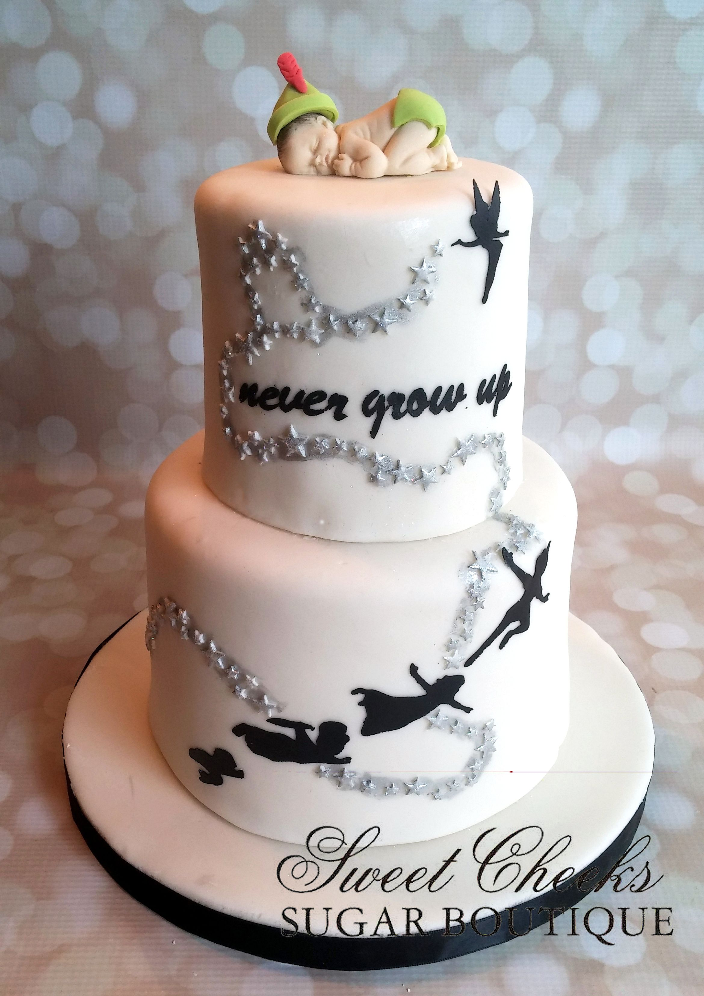 A Peter Pan themed baby shower cake