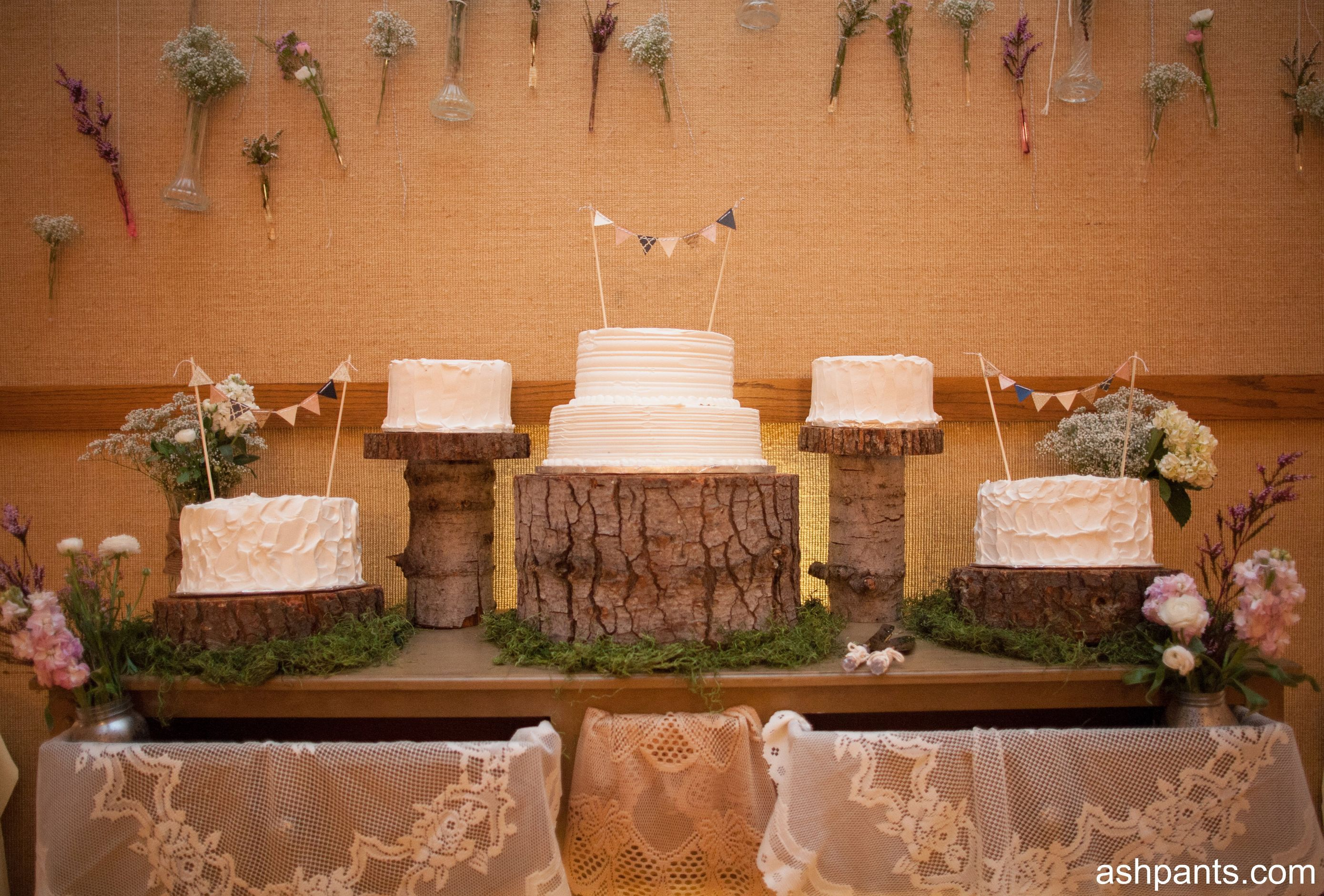 Ashpants white wedding cake with flag toppers and rustic wood cake
