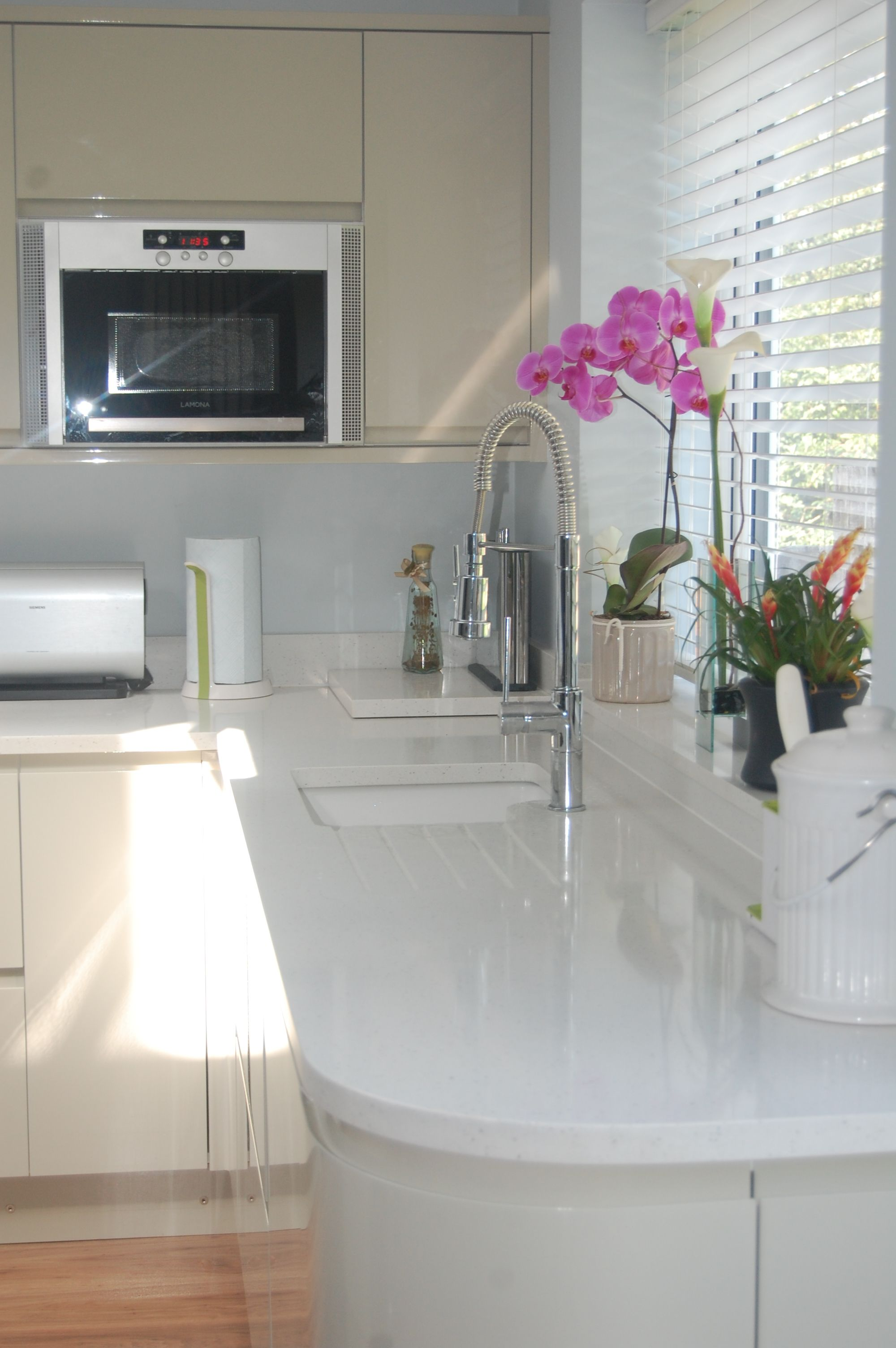 White Kitchen Quartz compac moon white quartz worktops with cream kitchen cabinets
