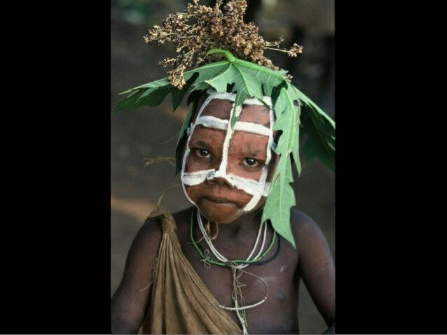 Gridded child with headdress,  Omo valley Ethiopia, photo Hans Silvester