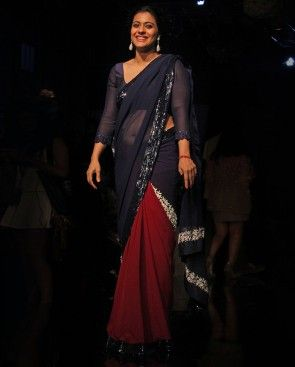 Kajol in Manish Malhotra Navy blue and maroon - what a lovely colour combination! We're a fan again of the 3/4 sleeve blouse and the lace detail at the end of the sleeves. Indian designer - Indian couture #thecrimsonbride