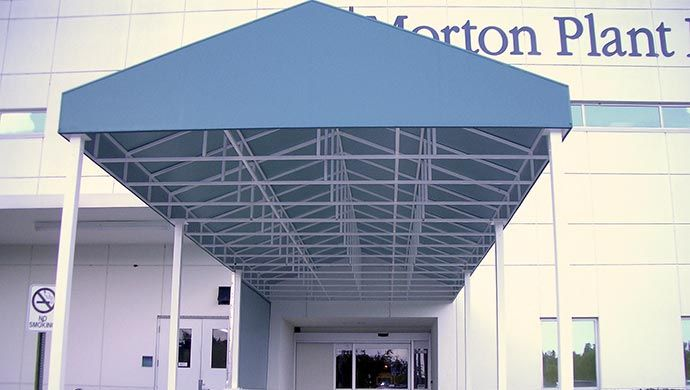 Awning Worksu0027 walkway and entrance canopies are available in both fabric and aluminum. Ask us about MRI walkway canopies. & Walkway Canopies - Awning Works Inc. | Commercial Walkway Canopies ...
