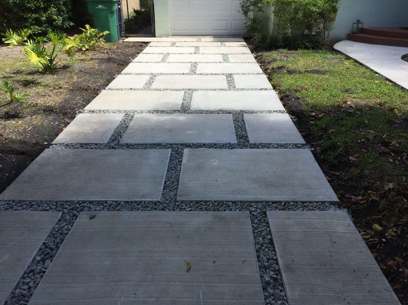Concrete Paver Staggered Squares Design With 1 Gray Granite