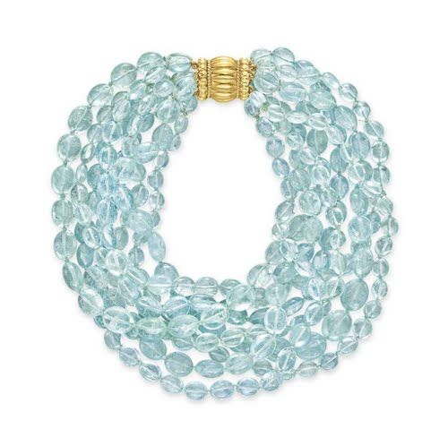 AN AQUAMARINE BEAD NECKLACE, BY VERDURA  Comprising eight strands of variously-shaped aquamarine beads, joined by an 18k gold clasp, mounted in 18k gold, 16 ins., two strands deficient, in a Verdura navy leather case Signed Verdura Christie's Price $13.750