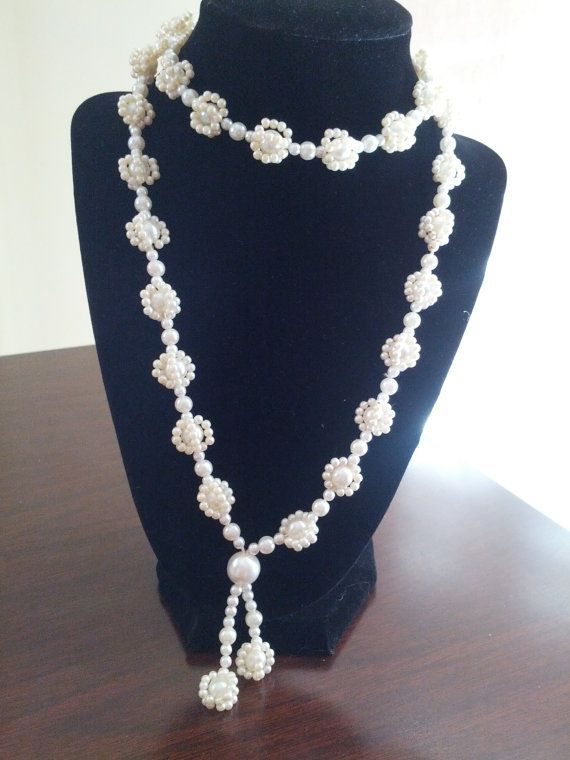 Check out this item in my Etsy shop https://www.etsy.com/listing/194021266/faux-pearl-necklace-with-a-beautiful