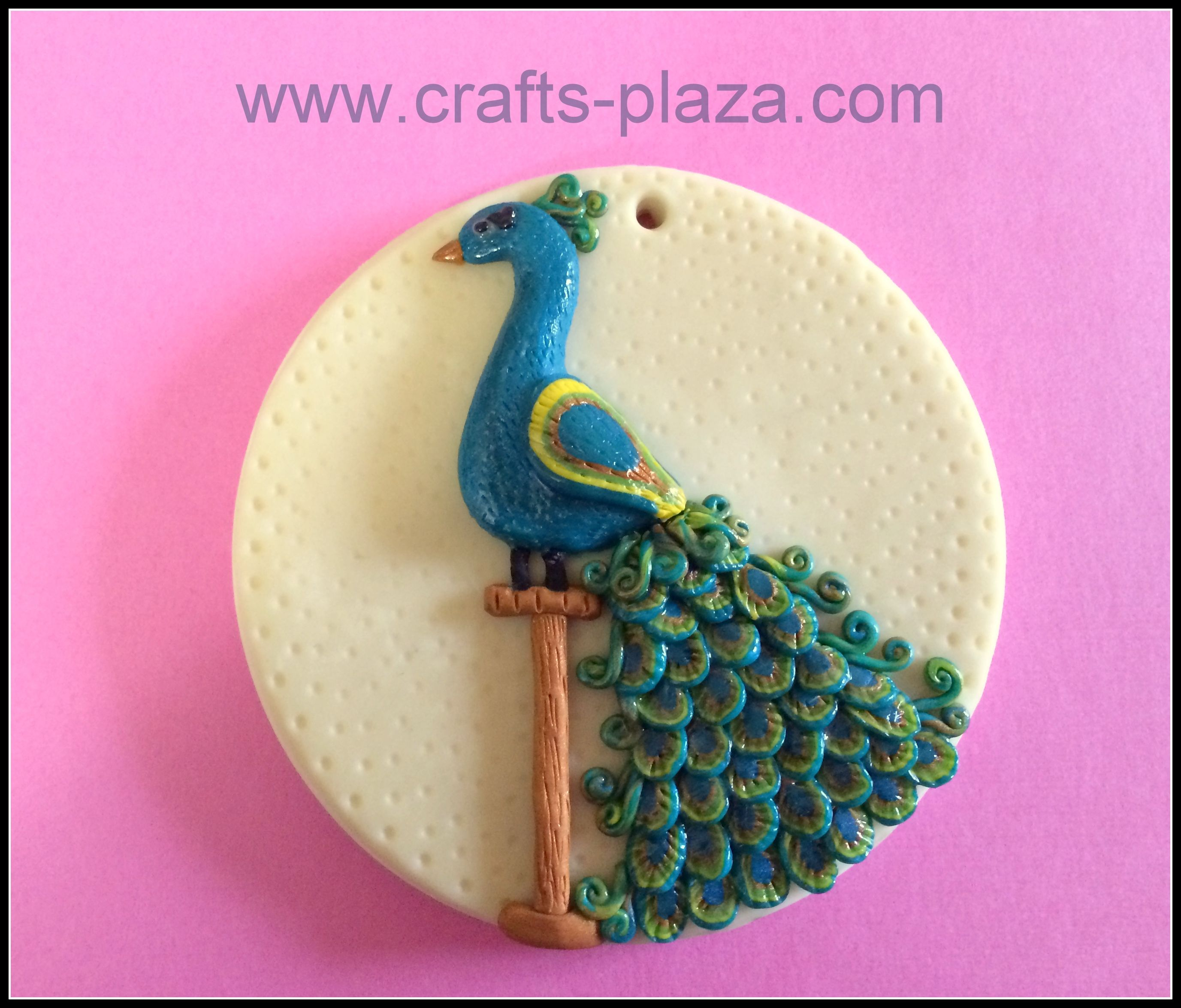 Peacock wall hangingornament made with polymer clay used a used a ceramic tile as base the white background glows in dark dailygadgetfo Images