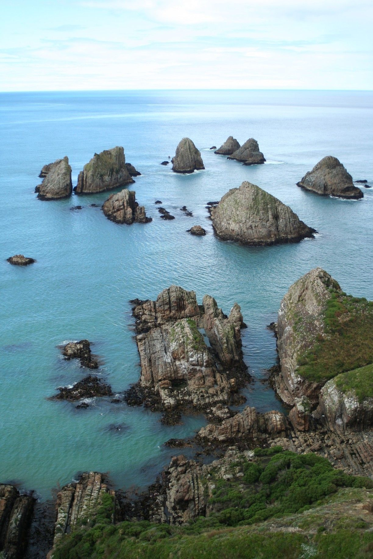 Nugget point lighthouse ahuriri flat new zealand u by chickbill