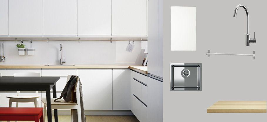FAKTUM kitchen with ÅRSTA white doors/drawers and PRÄGEL light oak ...