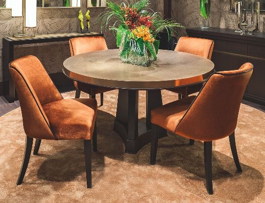 The table Murat by Oasis, with a bronze special finishings and wooden base, it's inspired to Art Decò design.