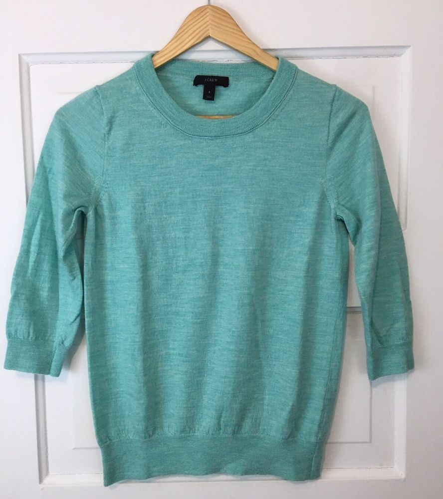 Women's Tippi sweater in merino wool. Heather blue/green. 3/4 ...