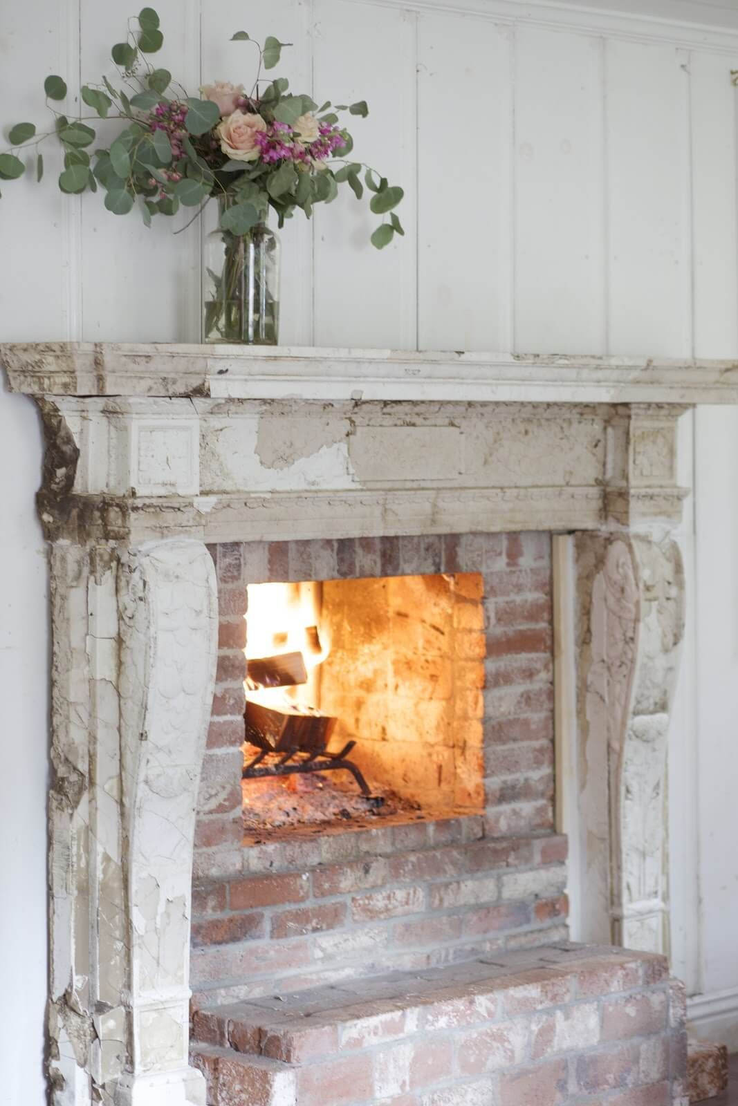 French Country Fireplace Distressed Wood Burning Fireplace With Flowers Stuff I M Lovin