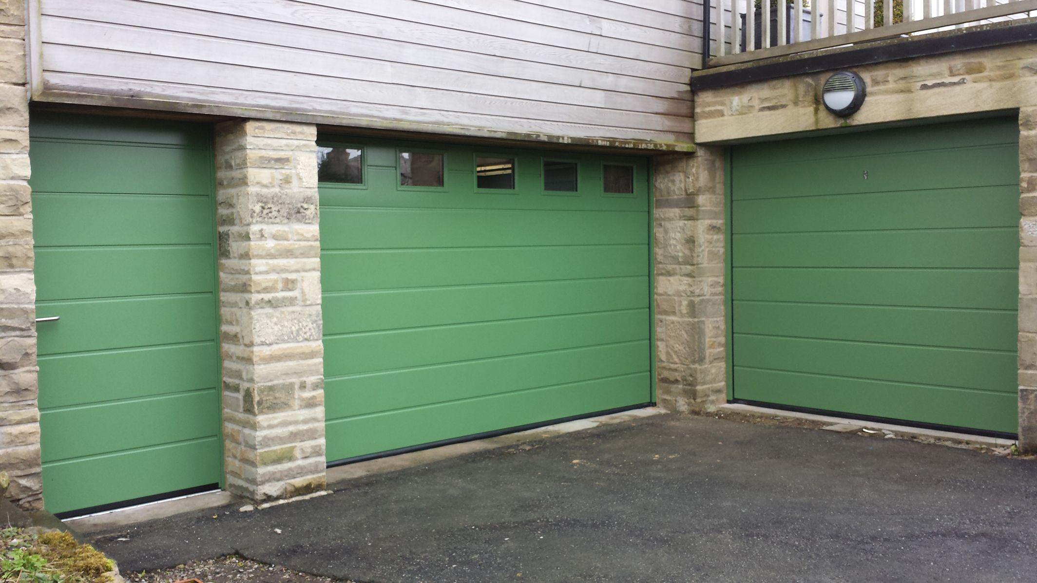 Hormann lpu40 insulated 42mm sectional garage doors in reseda hormann lpu40 insulated 42mm sectional garage doors in reseda green ral 6011 with style s0 windows rubansaba