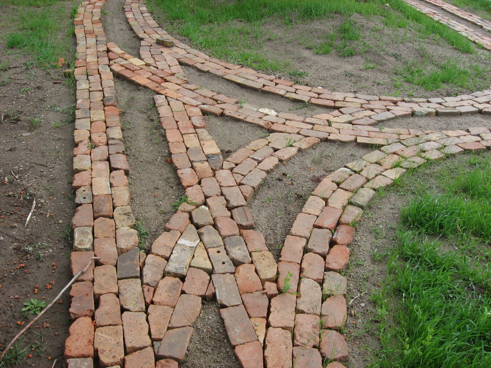 Reclaimed brick garden path under constructions dirt for Paving designs for small garden path