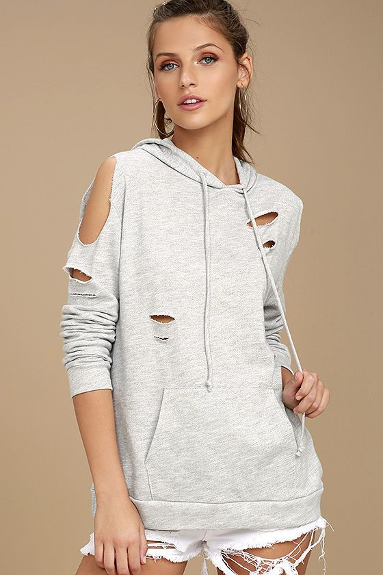 4481486513b7 Your favorite hoodie gets an edgy update with cold shoulder cutouts and  distressing throughout. Drawstring hood and long sleeves ...
