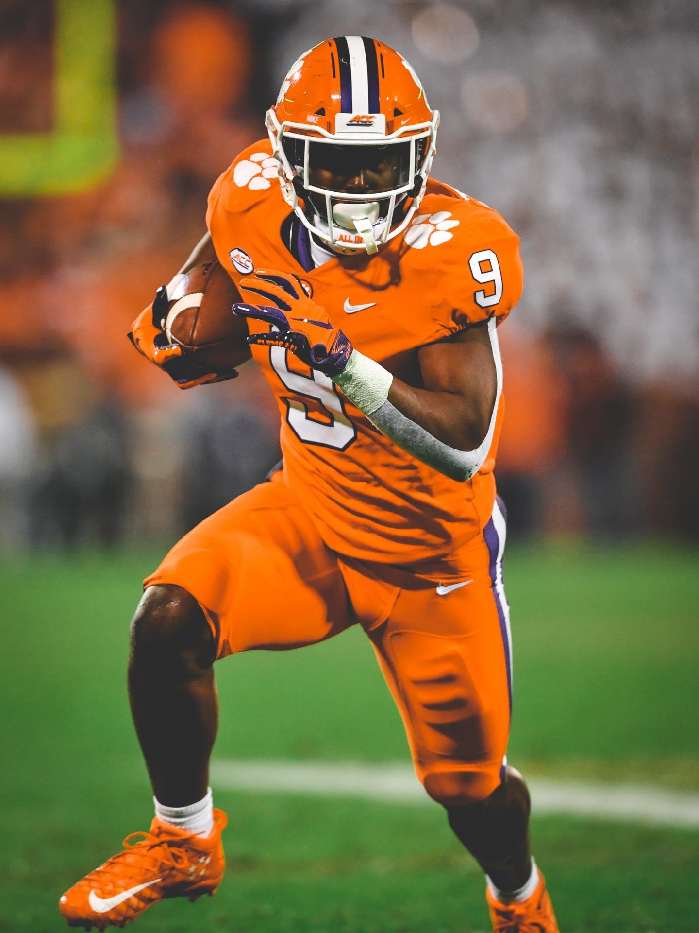 Travis Etienne heads up field for a big gain against South