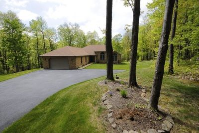 Originally listed at $495,000 Recently reduced to $418,500 126 Mineral Springs Rd Hopwood, PA 15445 Mountain property (Jumonville). Brick ranch on private 8.7 acres. Great location; Hunt from...