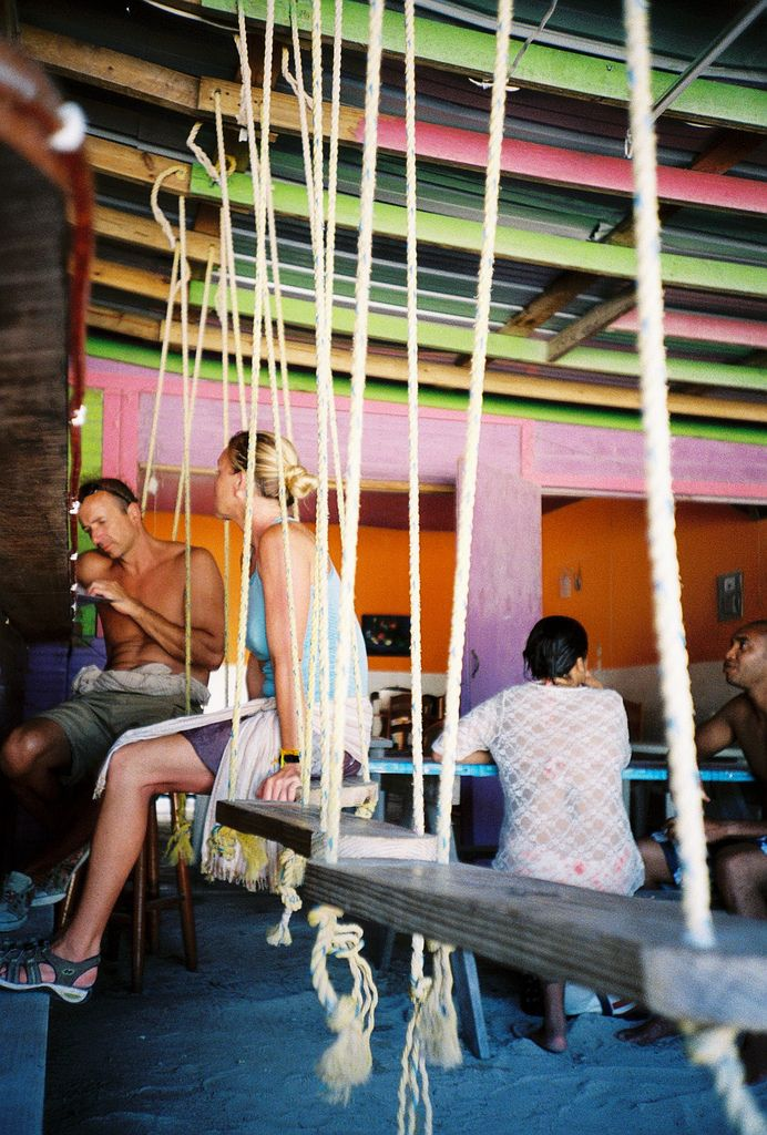 Photo of the Day – Enjoy Restaurant and Bar, Caye Caulker, Belize or ... How Swings Can Help Prolong Your Drinking