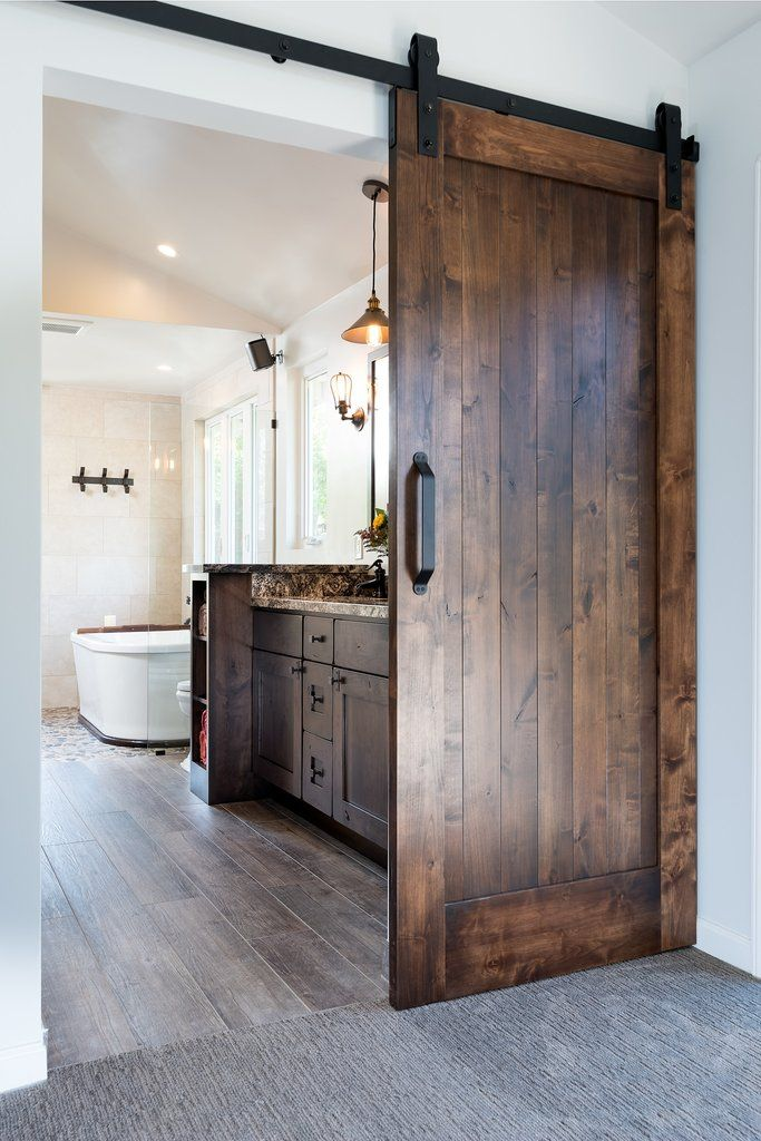 Barn door opens to modern master bathroom for two