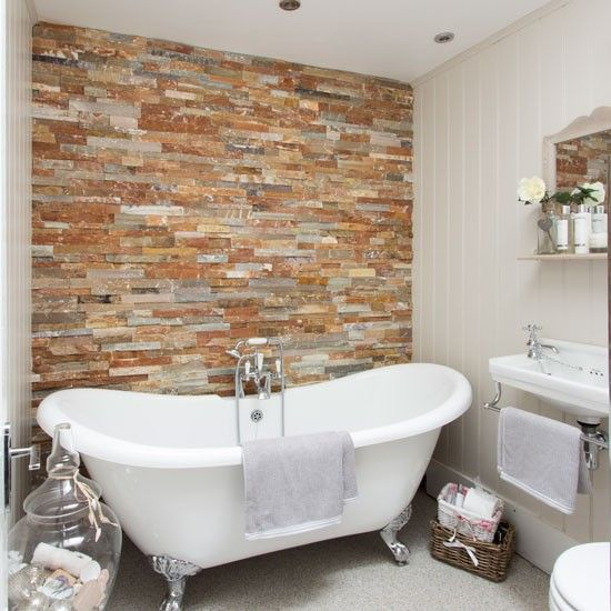 A Stylish Bathroom With A Brick Feature Wall