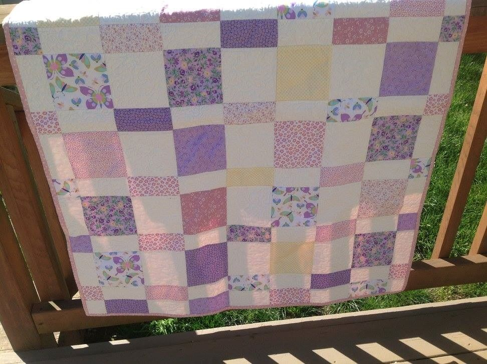 This custom wildflower baby quilt was ordered by Grandma for her brand new granddaughter, Lily.