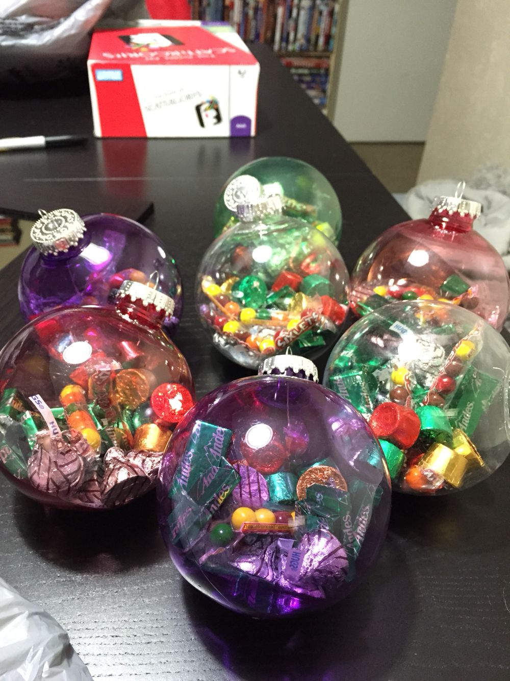 really cute cheap treat bag idea great for coworkersteachersfriends etc the plastic ornaments cost 97 at walmart and then just add small candy