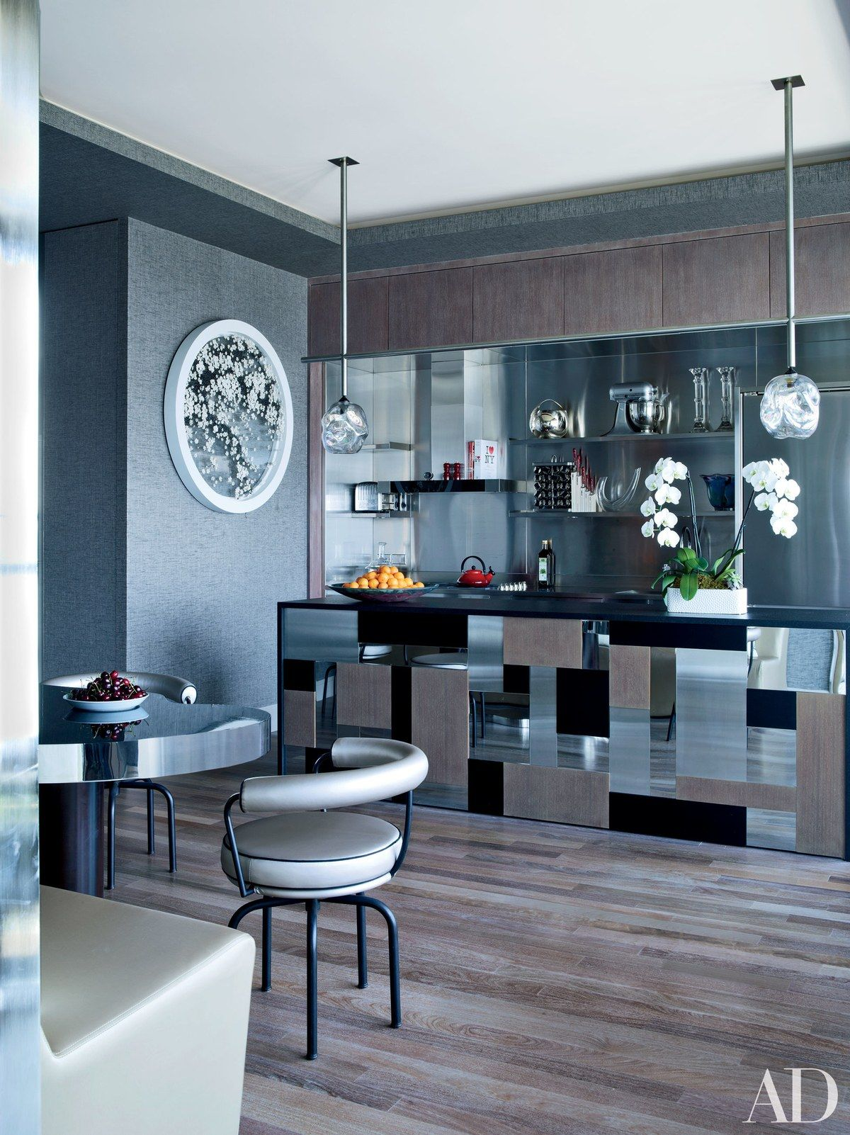 The symphony of reflective surfaces in the kitchen includes the ...