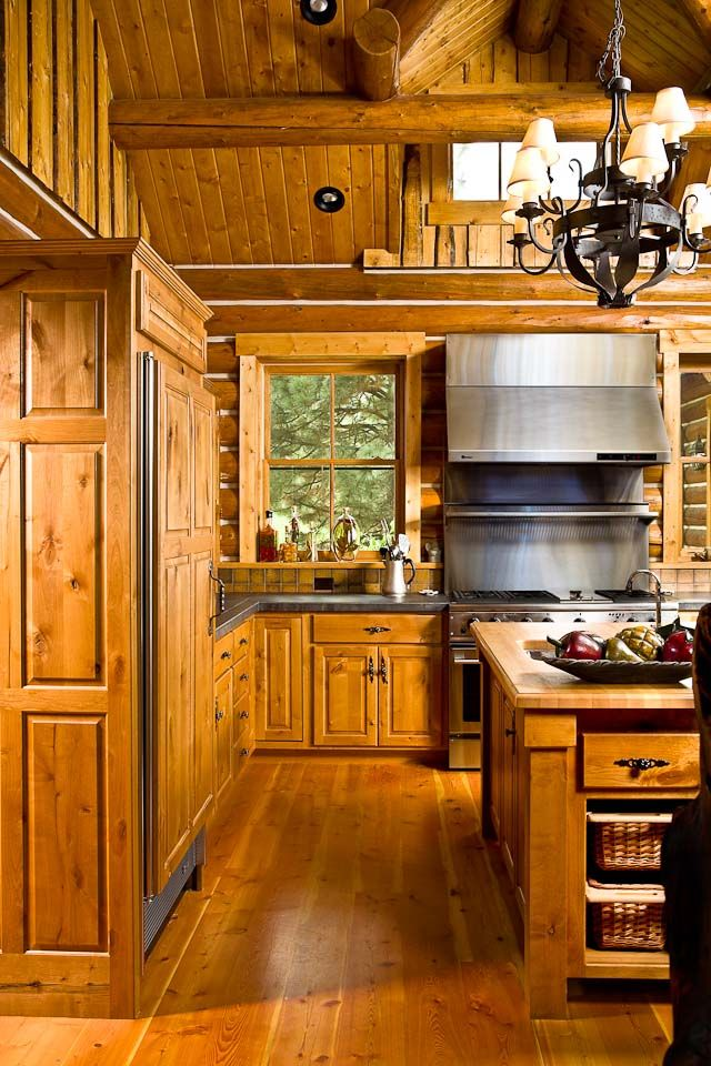 Country Rustic Kitchen With Black Hardware Paneled Refrigerator Interieur Keukens Chalets