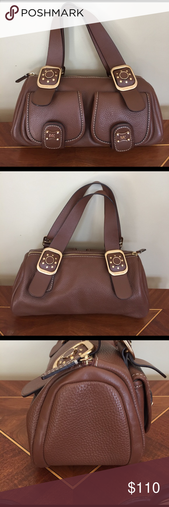 "Michael Kors Pebbled Leather Bag PRICE FIRM Michael Michael Kors Brown Pebbled Brown Leather Bag. This is Has been worn but in good Used Condition. Some marks and wear on bag. Measurements appropriately 6 1/2"" H x 12"" x  5""  6 1/2"" Strap Drop. Please see Photos! Ask Questions! Michael Kors Bags"