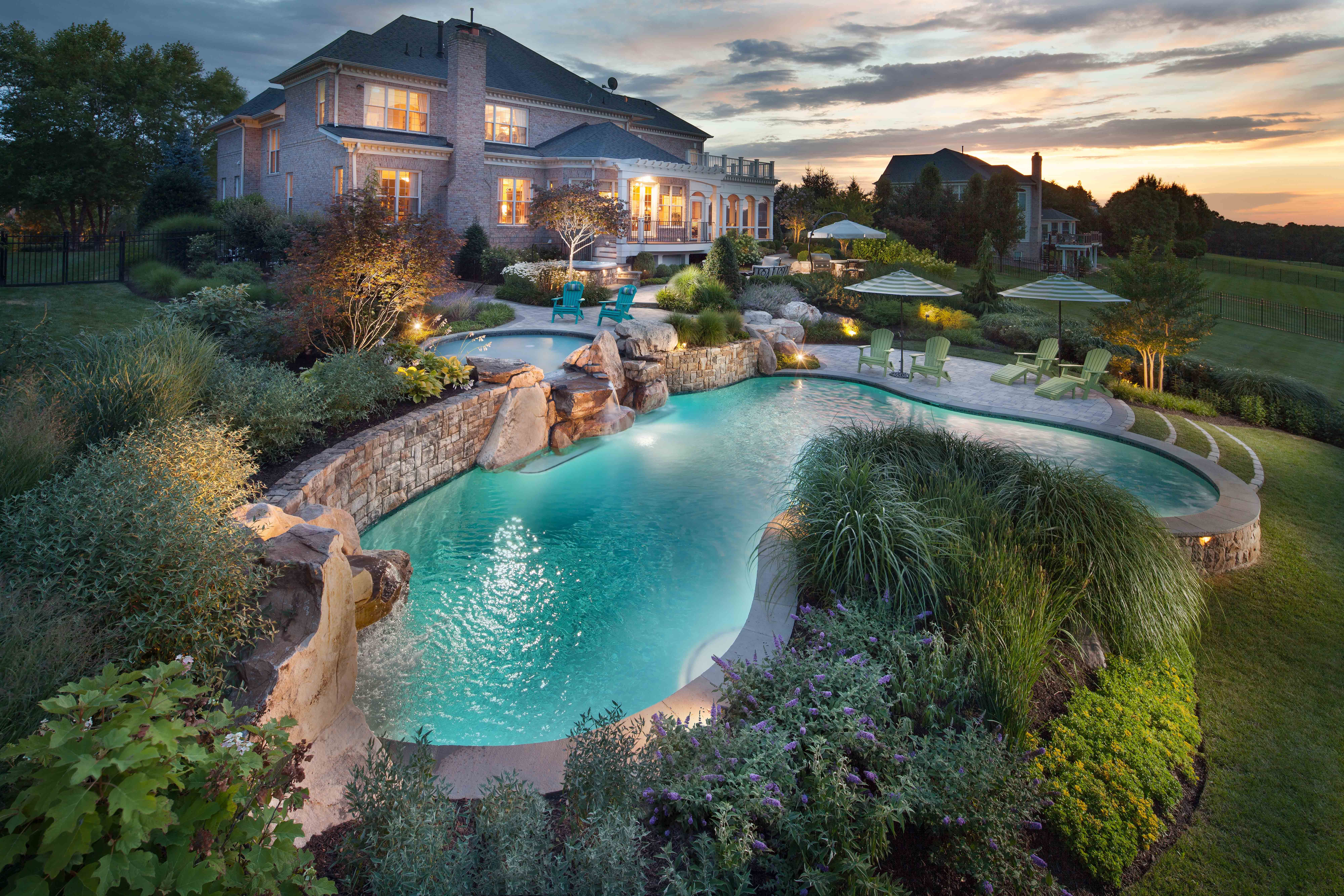 Beautiful backyard oasis. | Pools with landscaping ...