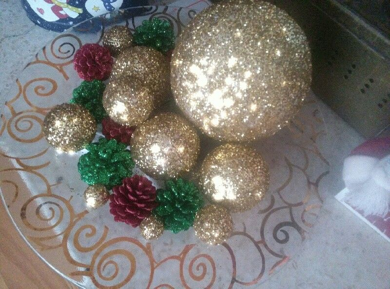 My first Christmas Ornament arrangement... Styrofoam balls and pinecones with lots of glitter!! So fun t make!!