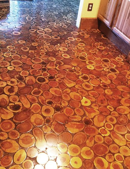 Lutz Used A Mixture Of Sawdust And Poly To Fill The Gaps Between Disks Diy Wood Floors House Flooring Cord Wood