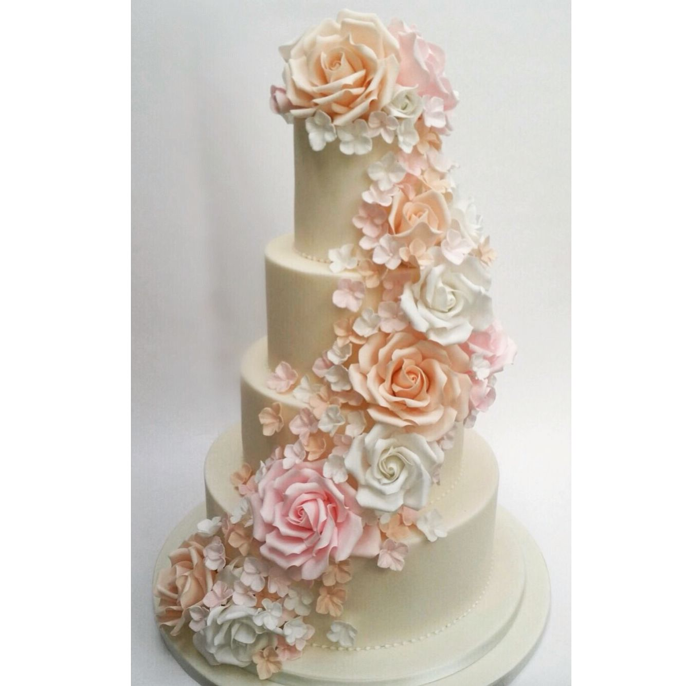 Wedding cake with cascading floral avalanche - Ivory cake with roses ...