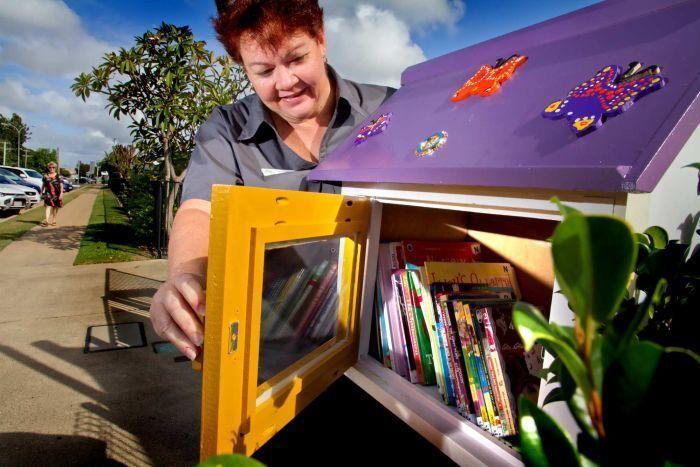 Sue Gammon checks out Bundaberg's new Little Free Library