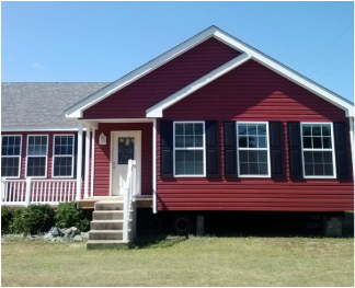 the rustic look this red vinyl gives this modular home ... on red houses, red decks, red siding,