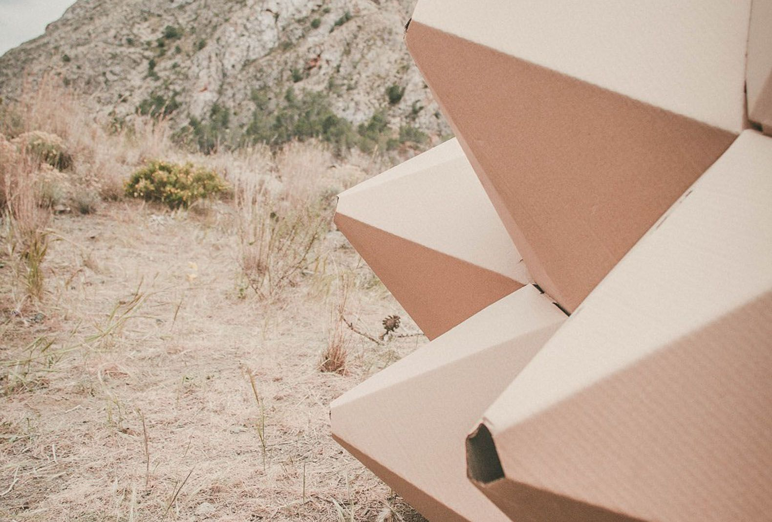 Tiny Helix Shelter made of laster-cut recycled cardboard is a temporary habitat for one