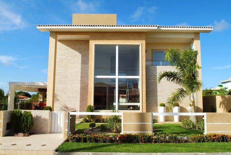 fachadas de casas modernas com muros e portes