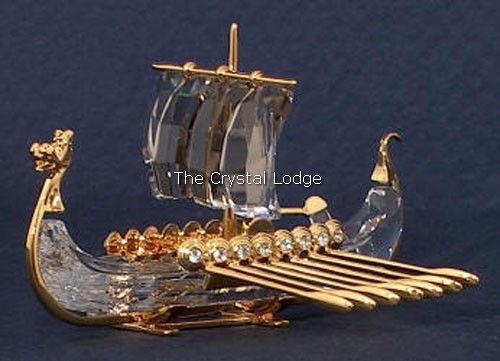 Swarovski code numbers: 267 879 / 267879 / 9461 000 014 This retired Swarovski Crystal Moments Viking ship was part of the Journeys theme and has gold metal detail. Size: 3 (75mm) long Designer: Team Introduced: 2001 Retired: 2004