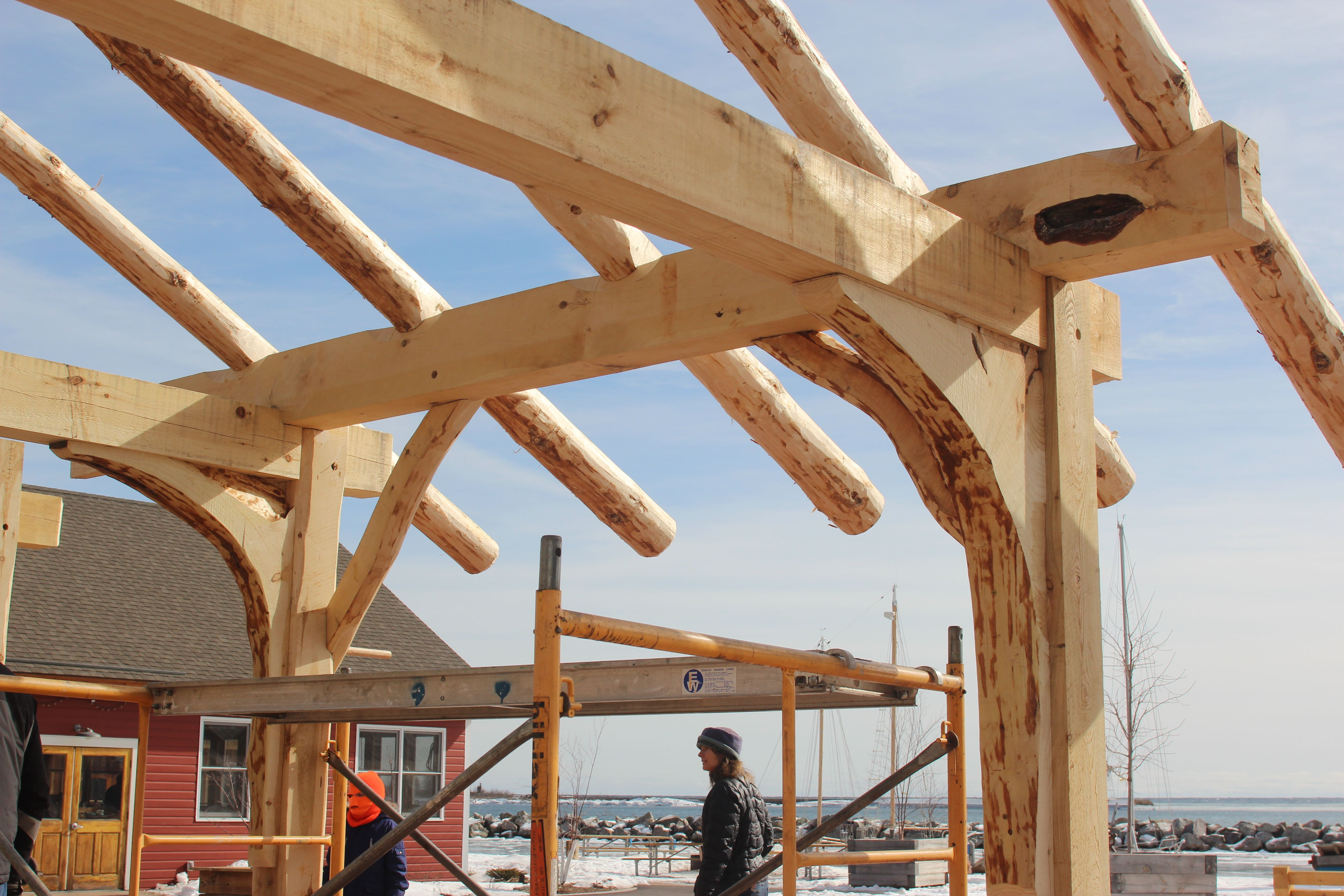 Timber frame construction building a traditional for Timber frame house construction