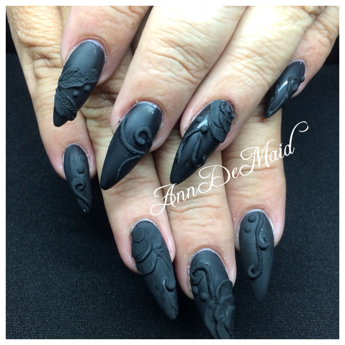 Acrylic nails with matte black gel polish and black acrylic 3D ...