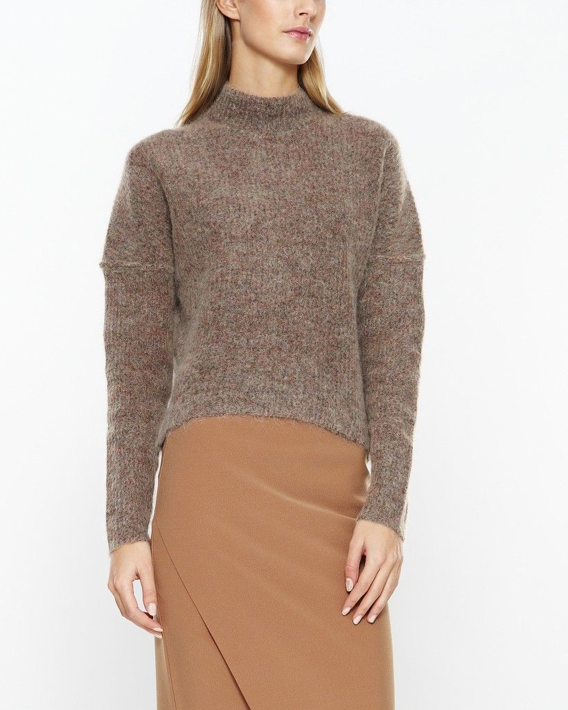Beautiful knit by By Malene Birger in a soft mohair-blend. Drop shoulders with raised seams and a high neck. Available in two lovely colors. Match with leather pants for a play on texture.