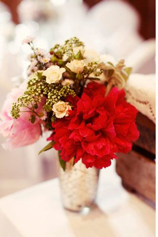 red peony floral centrepiece - Read more on One Fab Day: http://onefabday.com/a-beautiful-barn-wedding-by-rebecca-wedding-photography/