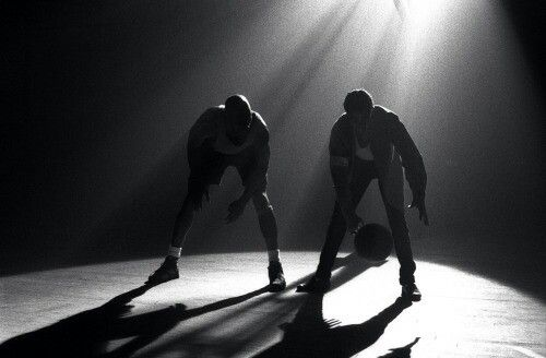 """The GOAT Michael Jordan checking out the King of Pop Michael Jackson's skill with a basketball on the set of Jackson's video """"Jam""""."""