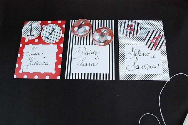 polka dots and stripes escort cards, with pins
